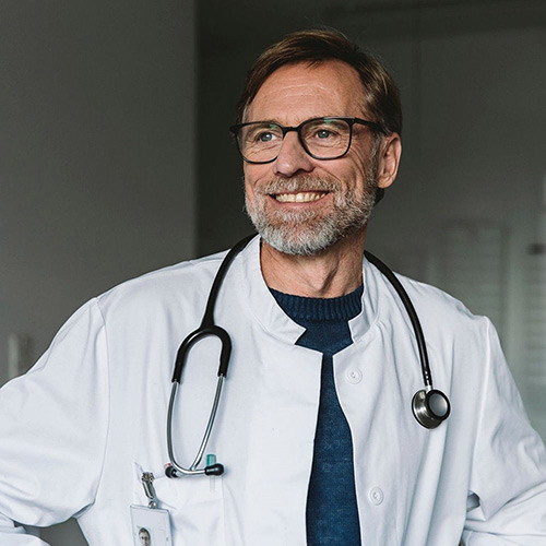 Photo of smiling male doctor